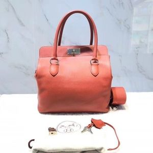Authentic Hermes Toolbox 26 in Salmon Color